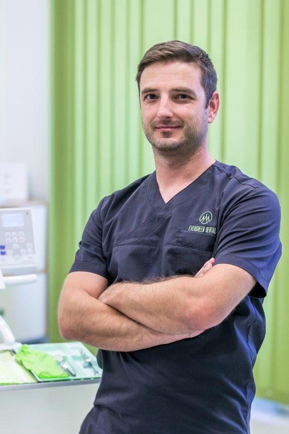 Dr. Attila Simay
